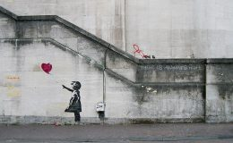 Girl with Balloon (also, Balloon Girl or Girl and Balloon) is a 2002-started London series of stencil murals by the graffiti artist Banksy, depicting a young girl with her hand extended toward a red heart-shaped balloon carried away by the wind. The first work was on Waterloo Bridge, and other murals were around London, though none remain there. Banksy has several times used variants of this design to support social campaigns: in 2005 about the West Bank barrier, in 2014 about the Syrian refugee crisis, and also about the 2017 UK election. A 2017 Samsung poll ranked Girl with Balloon as the United Kingdom's number one favourite artwork.